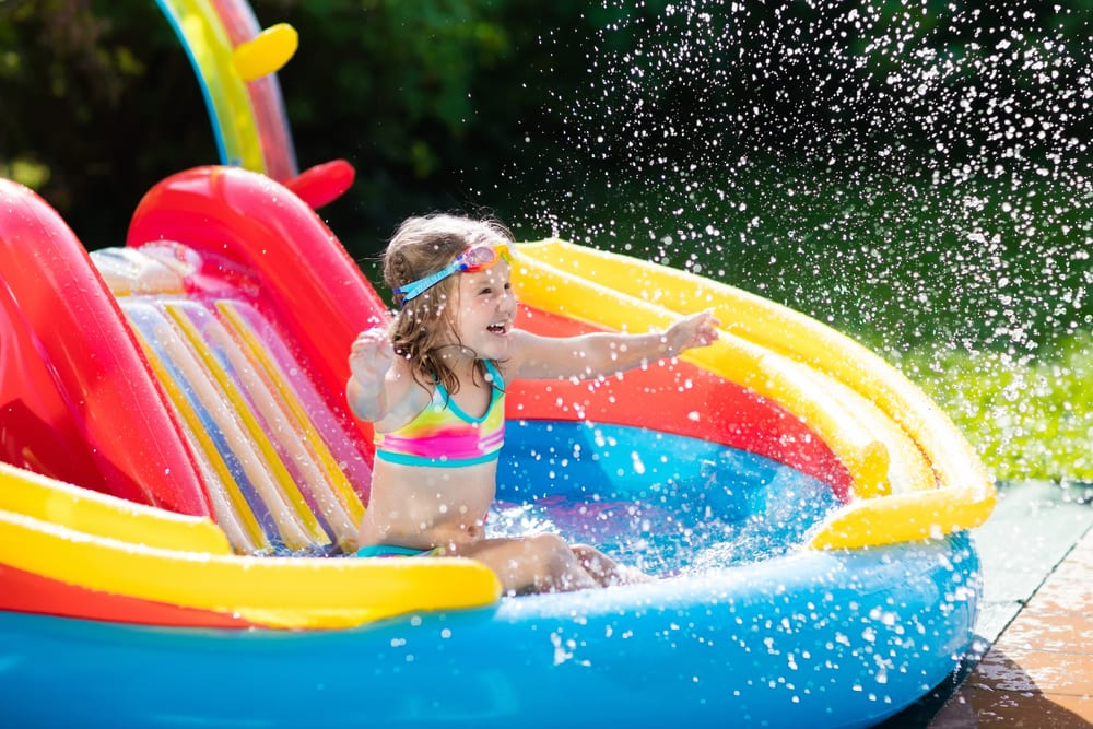 Child in inflatable pool (Photo: FamVeld/Shutterstock)