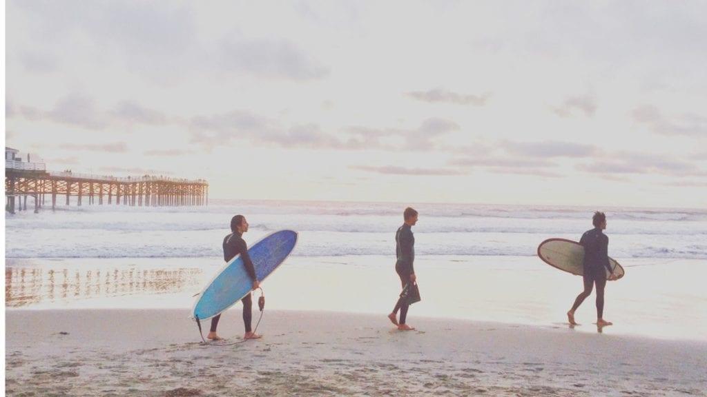 Surfers on the beach in San Diego (Photo: @TonyTheTigersSon via Twenty20)