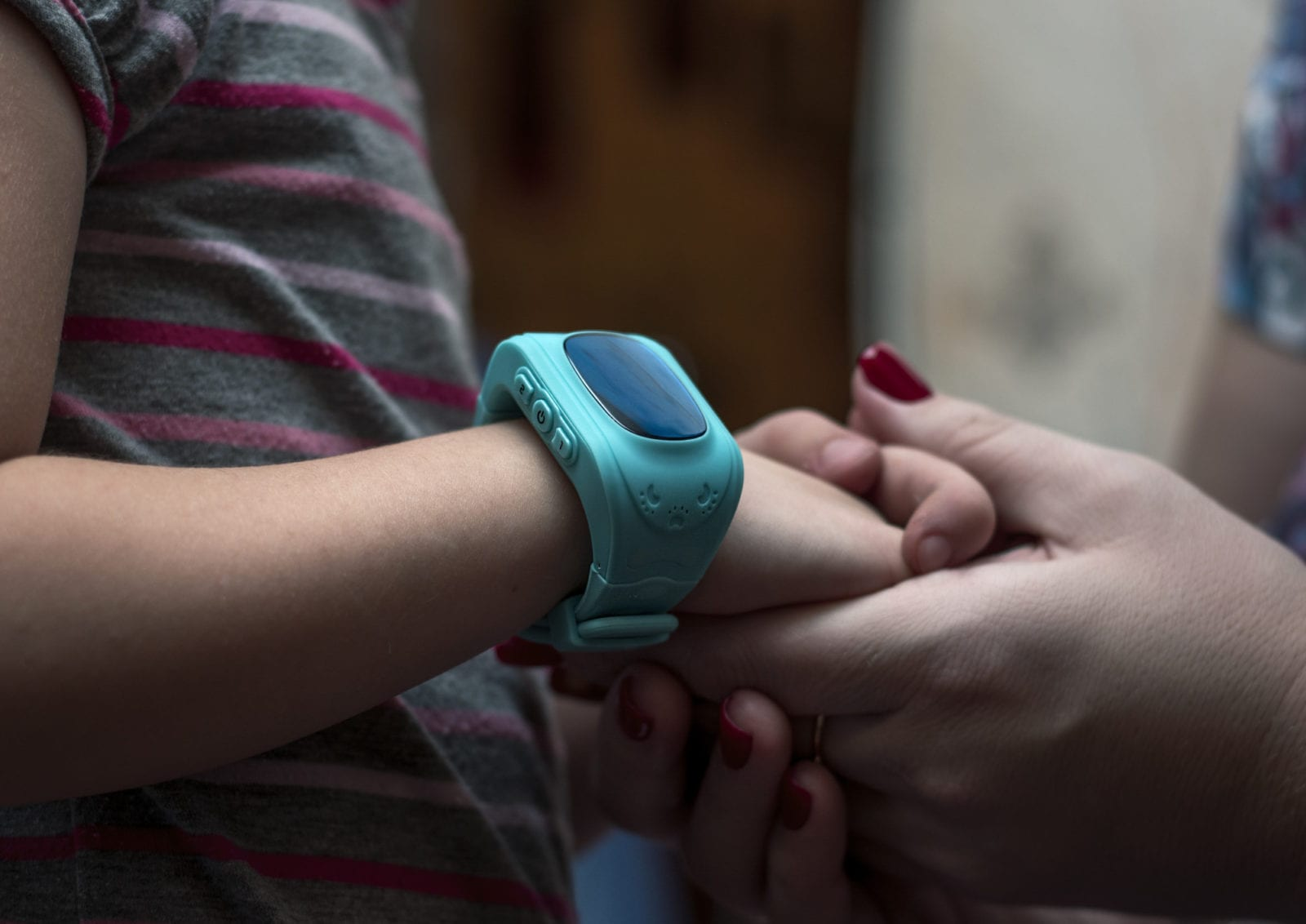 smartwatches for kids: parent holding a child's hand
