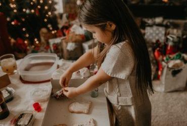child making Christmas cookies