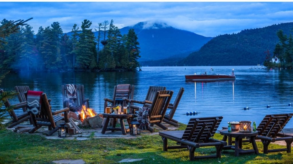 Lake, chairs, and campfire at Whiteface Lodge