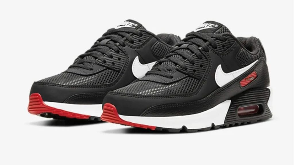 Pair of black, white, and red Nike Air Max 90 kids sneakers