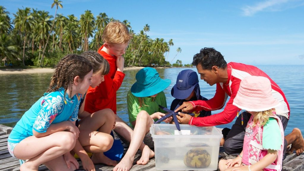 biologist teaching kids at the Jean-Michel Cousteau Resort in Fiji, one of the best beach all-inclusive resorts in the world