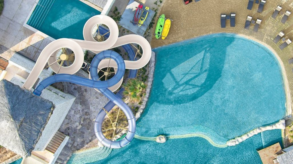 aerial view of waterslide and pool at Grand Solmar Rancho San Lucas, one of the best all-inclusive beach resorts