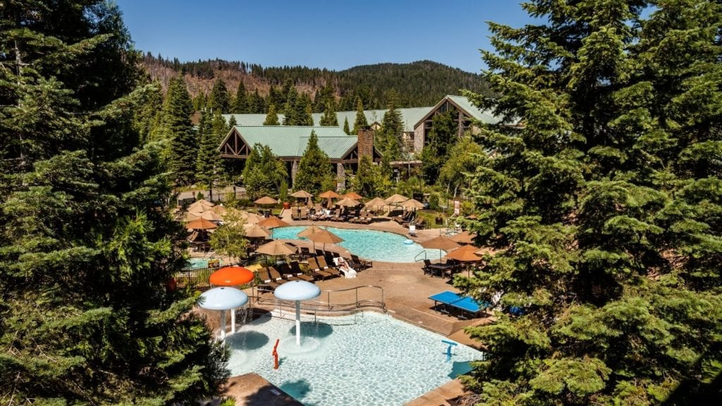 view of pools and buildings at Tenaya Lodge, places to stay near Yosemite