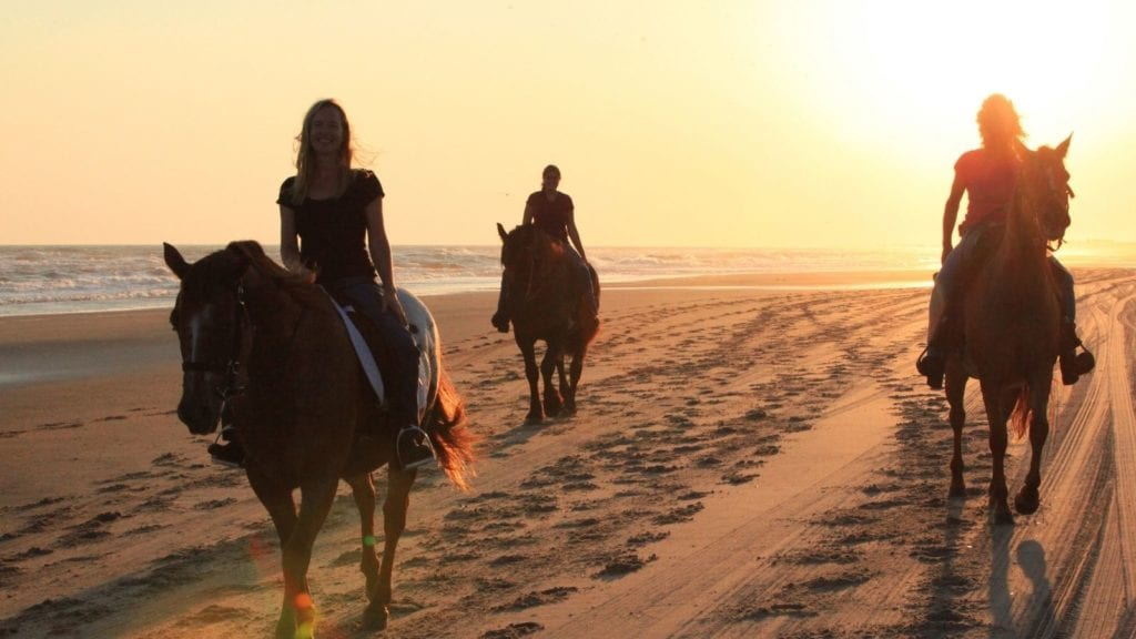 Horseback riding on the beach at Cape Hatteras, Outer Banks (Photo: Outerbanks.org)