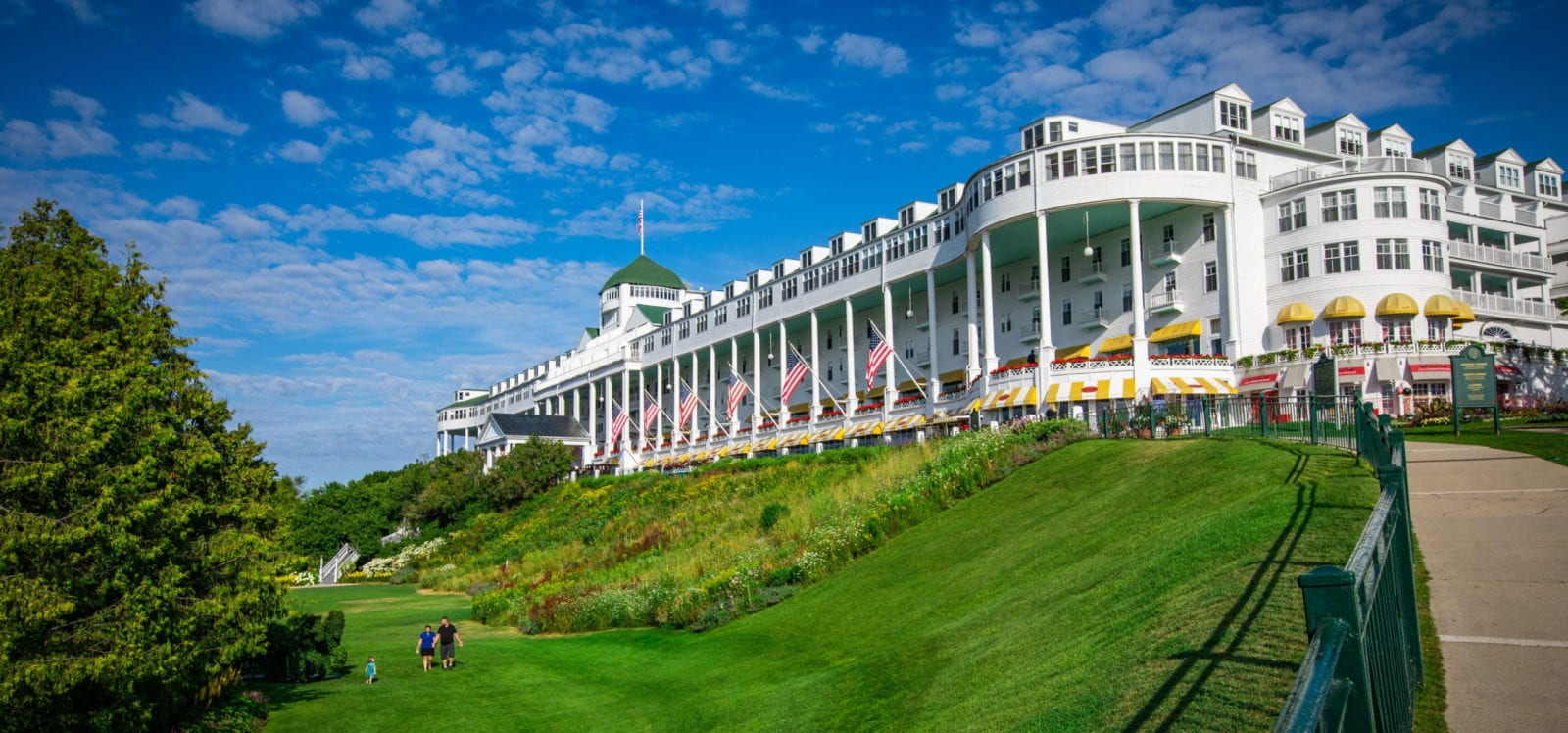 A family walks on the lawn at Grand Hotel on Mackinac Island, Michigan (Photo: Grand Hotel)