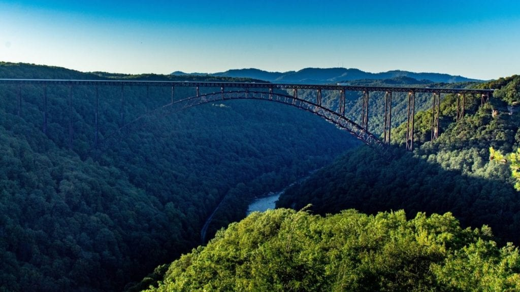 New River Gorge Bridge with sunlight and shade. This new national park is one of the best vacation spots for couples, especially outdoorsy people