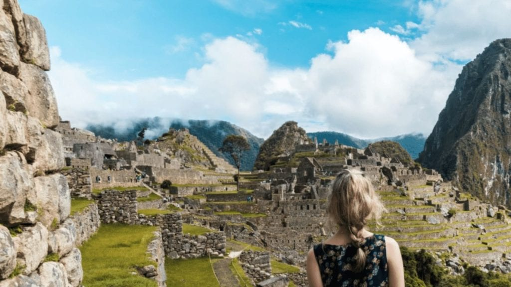 Young girl views Machu Picchu from a distance (Photo: Willian Justen on Unsplash)