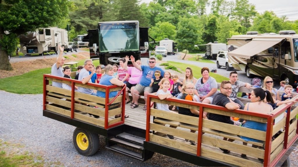 Campers waving from a hayride at Elizabethtown/Hershey KOA (Photo: Elizabethtown/Hershey KOA)