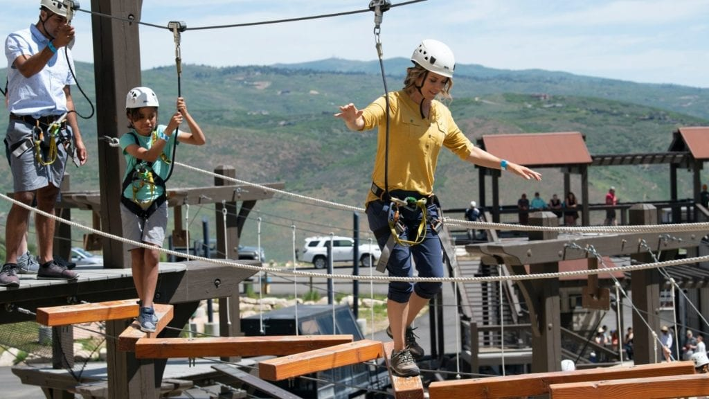 Mom walking across a bridge on the ropes course at Utah Olympic Park (Photo: Park City Chamber)