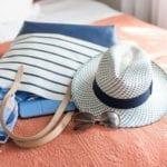 Beach bag and other summer essentials (Photo: Anna Hoychuk / Shutterstock)