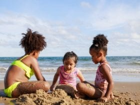 Kids building sandcastles at the beach (Photo: Chayantorn Tongmorn / Shutterstock)