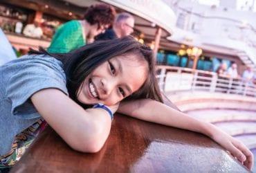 A young girl enjoys a family cruise (Photo: Anutr Yossundara / Shutterstock.com)