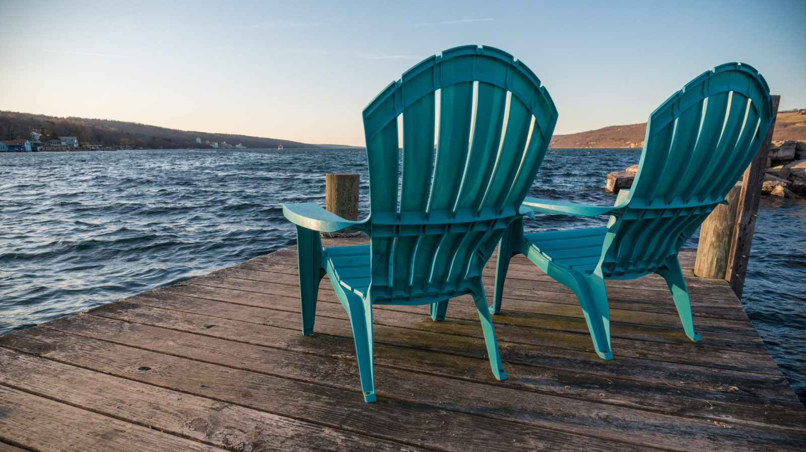 Chairs on a dock on Seneca Lake in New York State, a family vacation destination