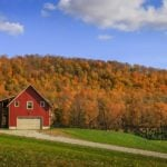 Colorful barn and fall foliage in Vermont, a fall vacation idea