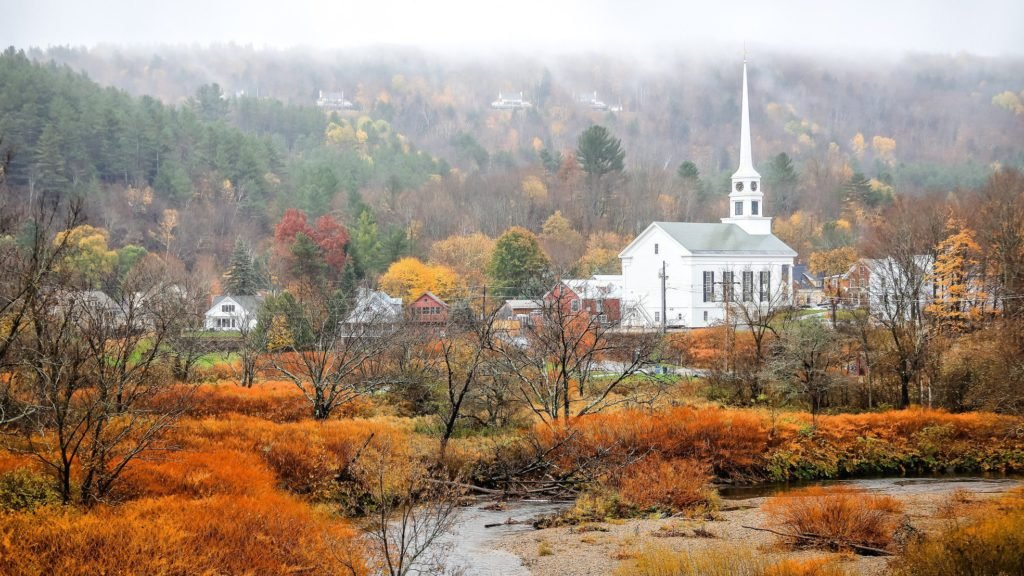 Stowe, Vermont with fall foliage and church