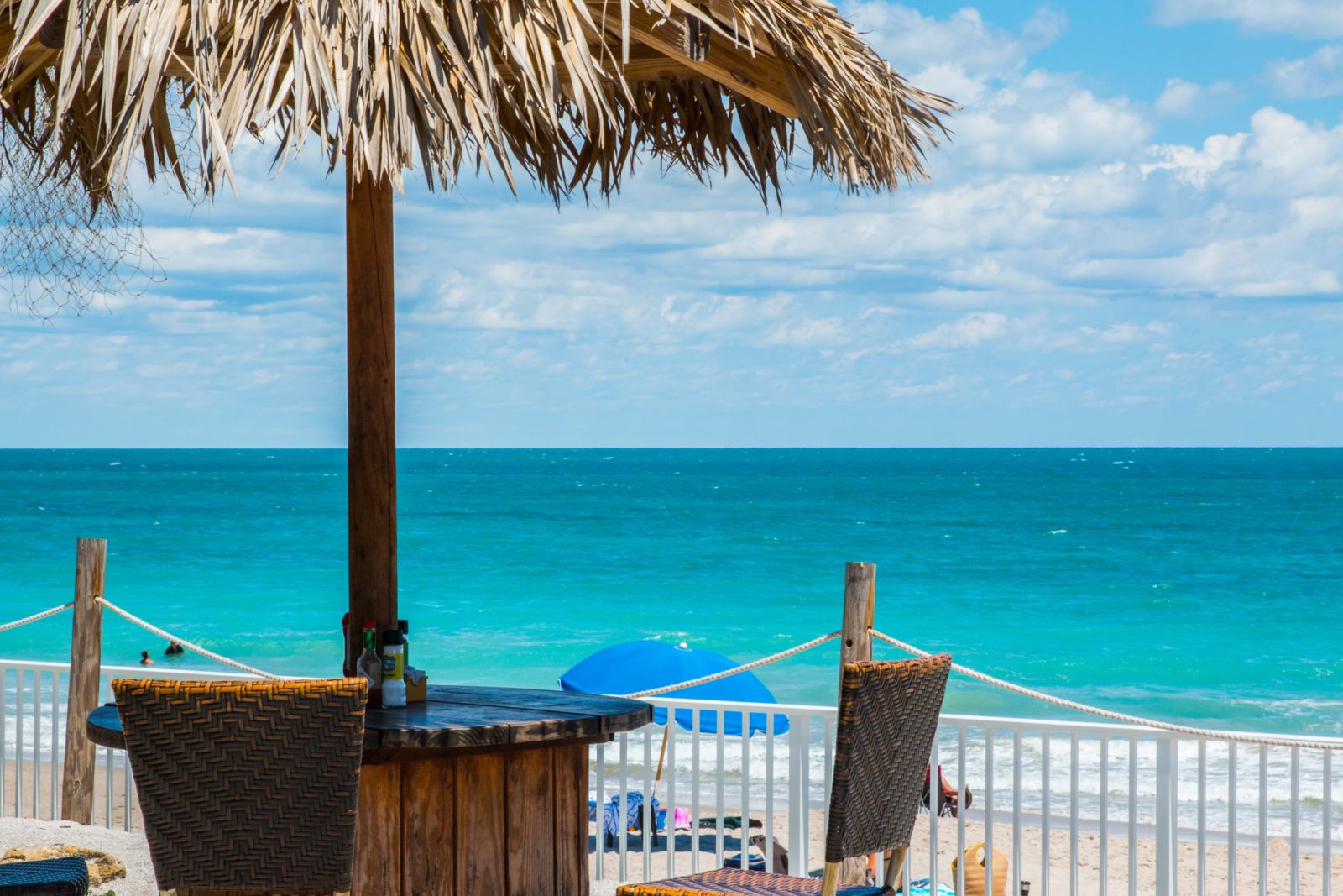 Thatched umbrella and table overlooking the water in Vero Beach Florida